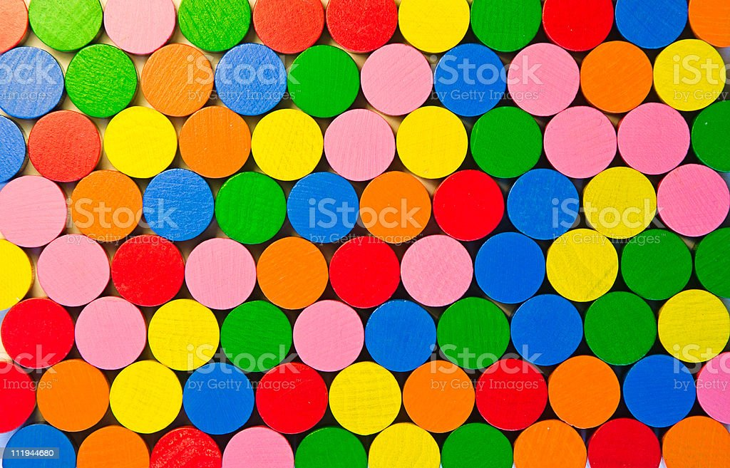 Colourful round wooden tokens stock photo