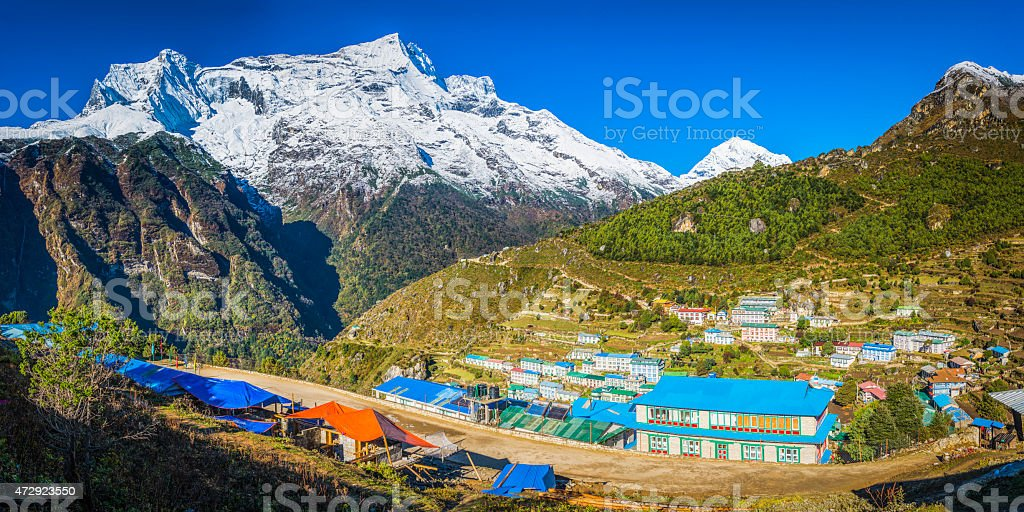 Colourful Sherpa teahouses Namche Bazaar Himalaya mountain village panorama Nepal stock photo