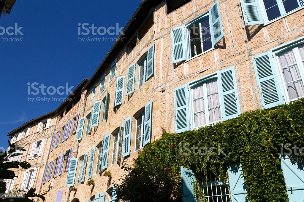 Colourful shutters in the streets of Figeac, Lot, France stock photo