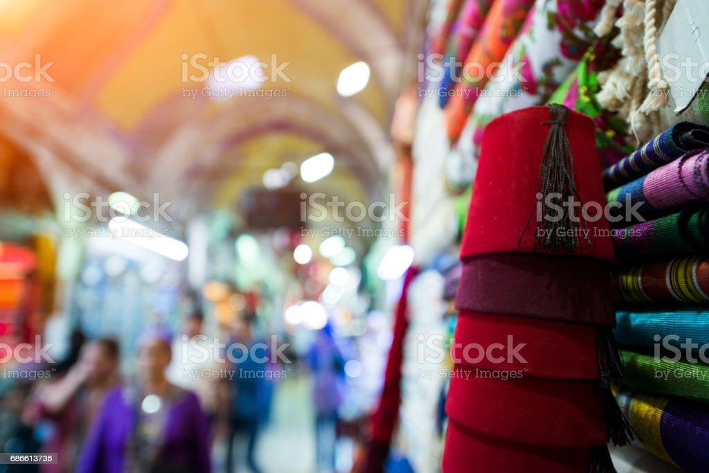 Colourful silk scarves and fez at a shop in Istanbul, Turkey stock photo