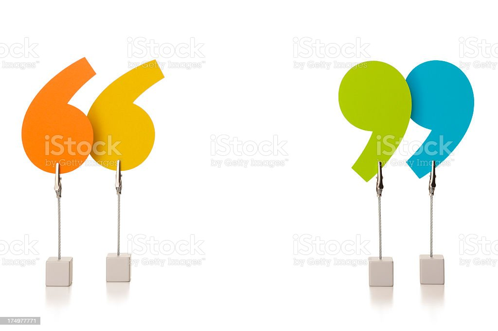 Colourful speech marks held in wire clamps stock photo