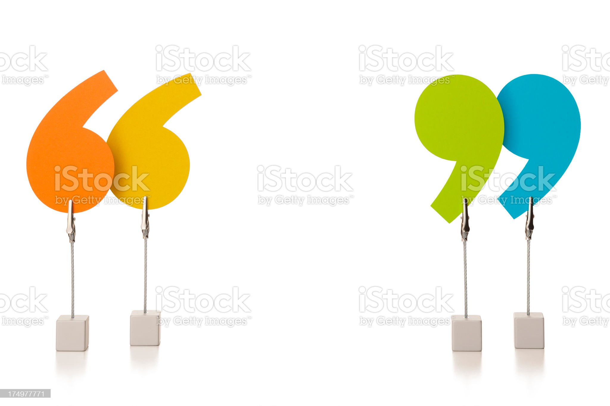 Colourful speech marks held in wire clamps royalty-free stock photo