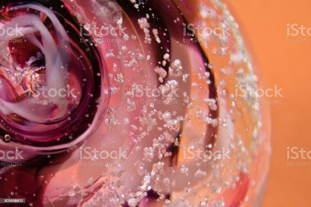colourful sphere gemstone close up macro on red range background abstract stock photo