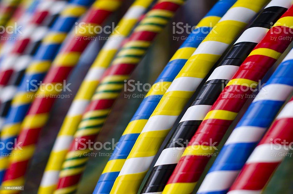 Colourful striped hula hoops stock photo