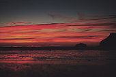 Colourful sunset over the beach at Polzeath Vintage Retro Filter