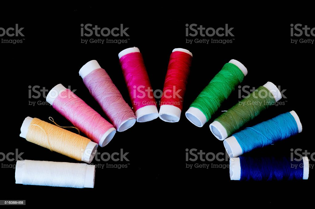 Colourful thread rolls in semicircle stock photo