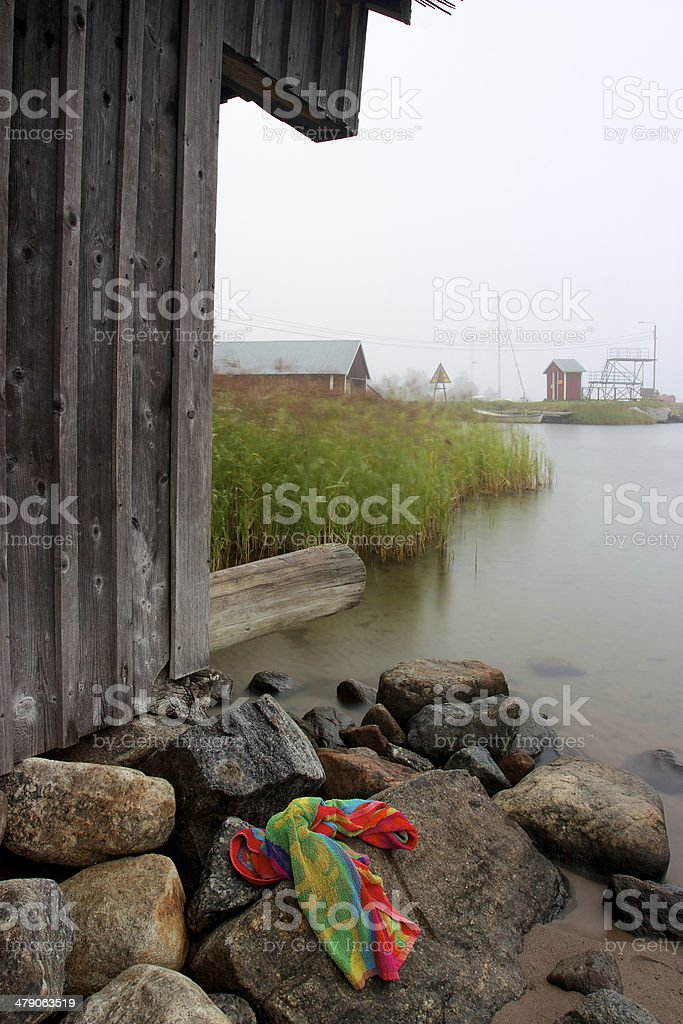 Colourful towel laying on rocks stock photo