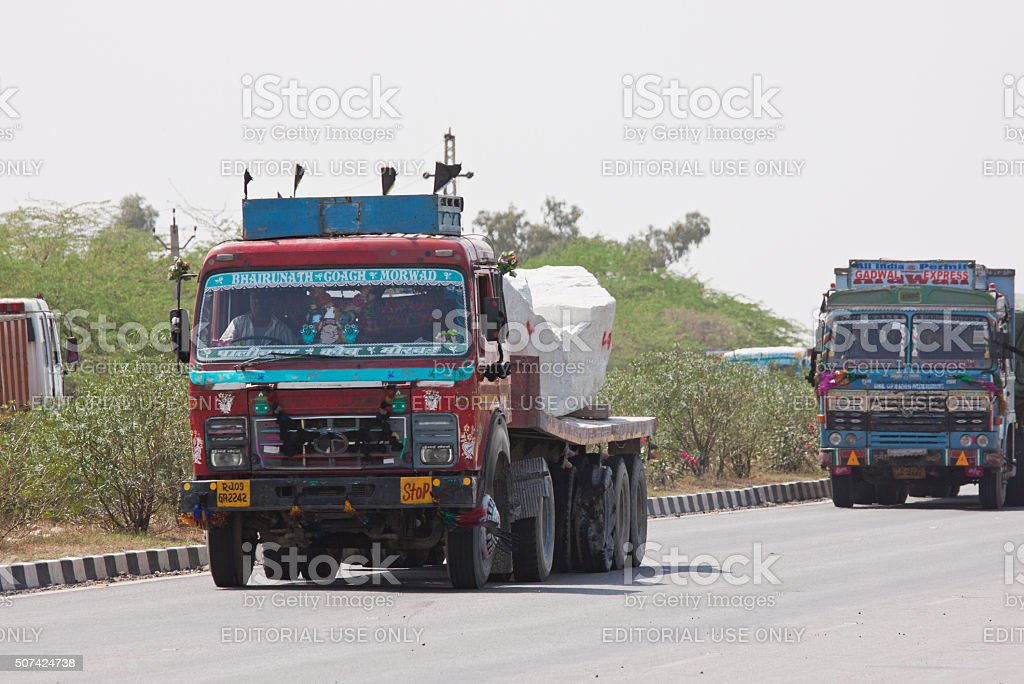 Colourful trucks on the Jaipur to Delhi state highway, India stock photo