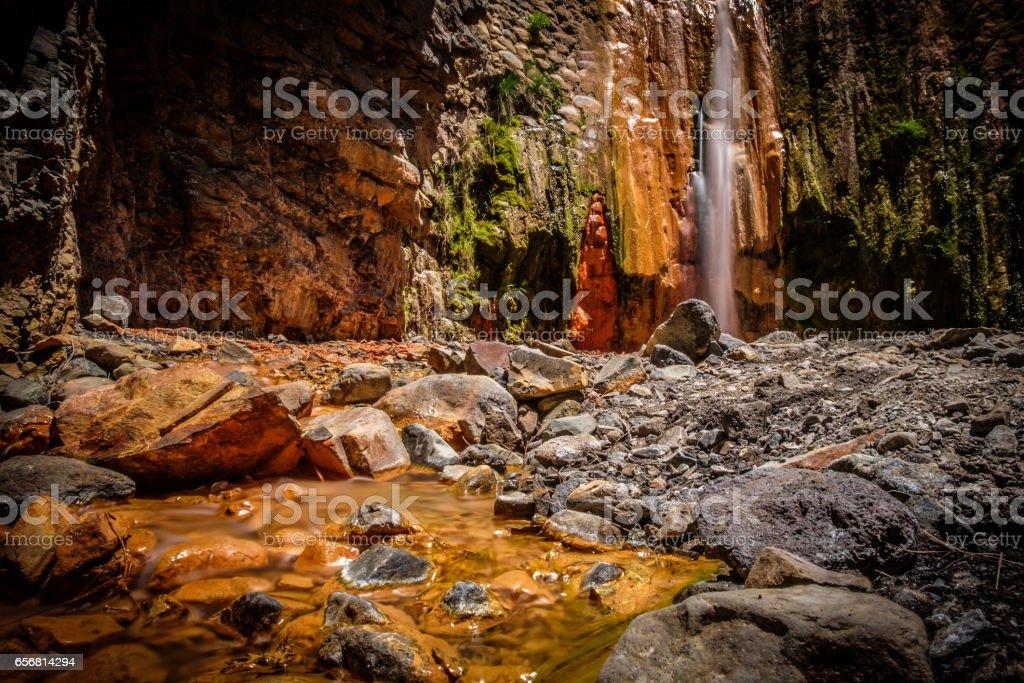 """Colourful waterfall """"Cascada de los Colores"""" at Caldera de Taburiente, La Palma, Spain. stock photo"""