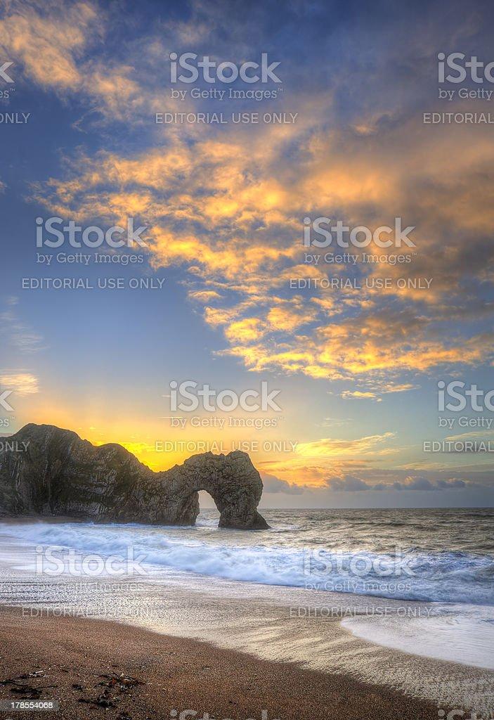 Colourful Winter sunrises behind Durdle Door on Jurassic Coast stock photo