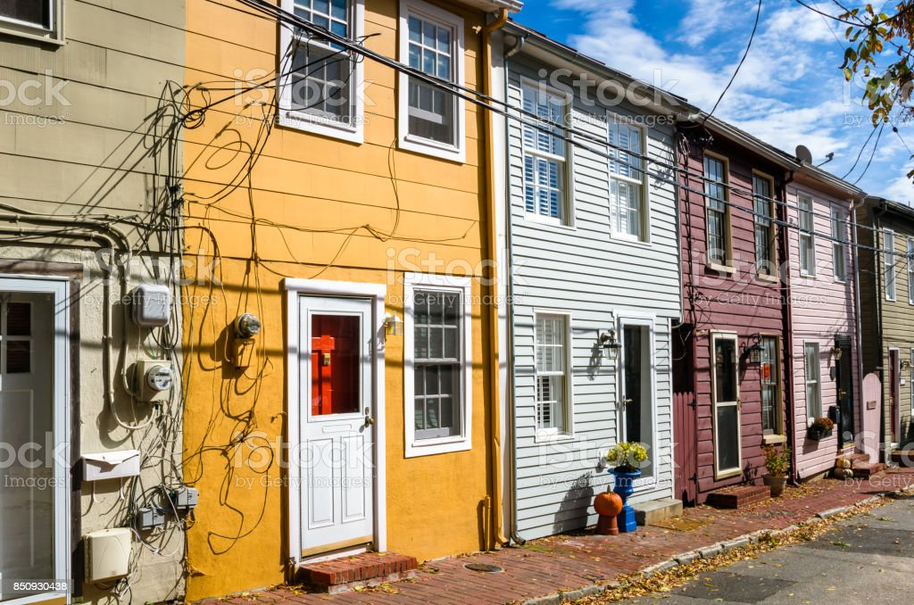 Colourful Wooden Row Houses on Sunny Day stock photo