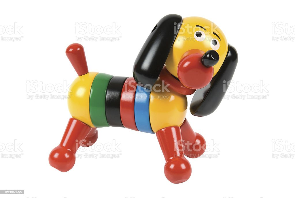Colourful wooden toy dog on a white background. royalty-free stock photo