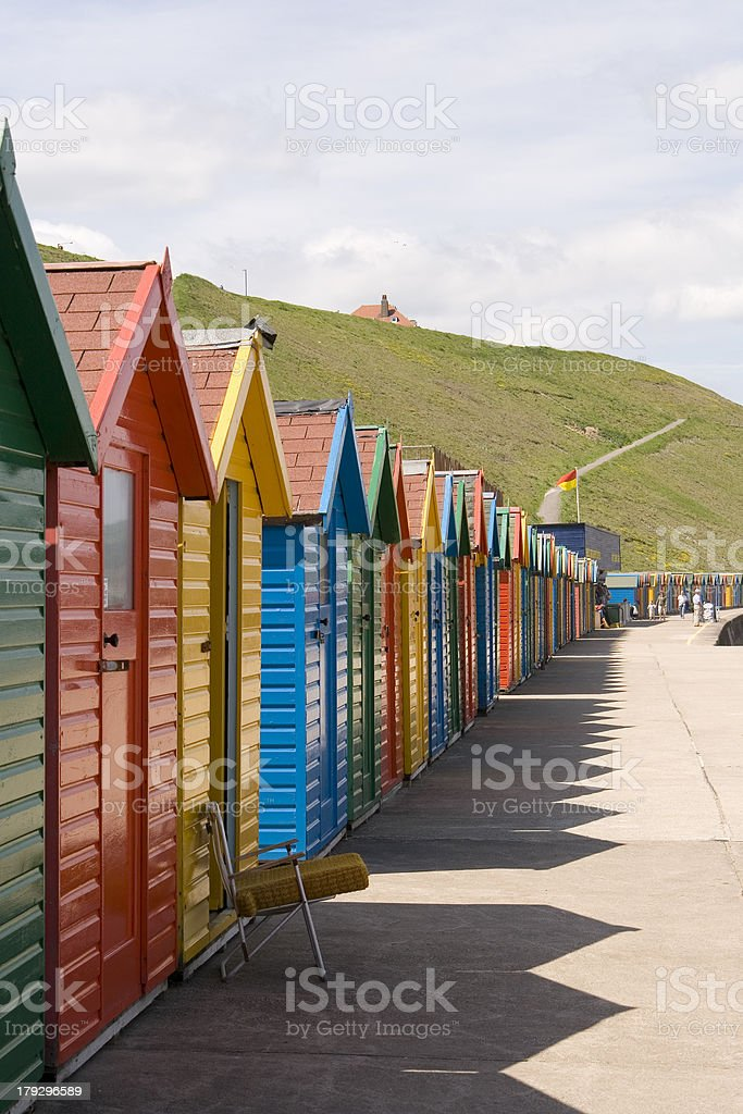 Colourfull painted beach huts at Whitby stock photo