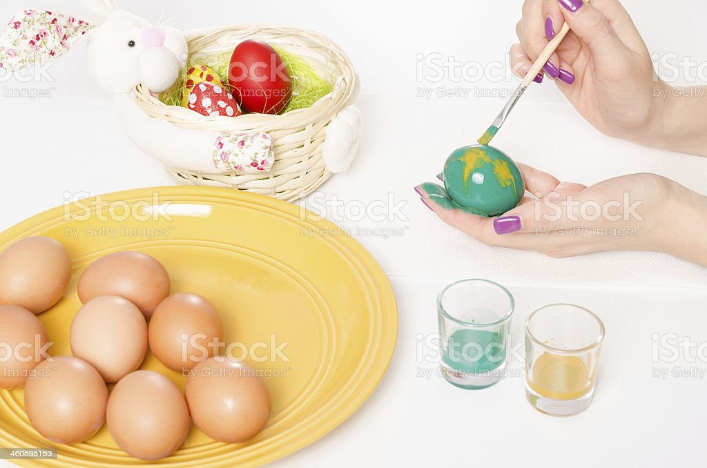 Colouring Easter eggs stock photo