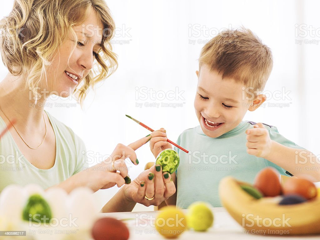 Colouring Easter eggs royalty-free stock photo