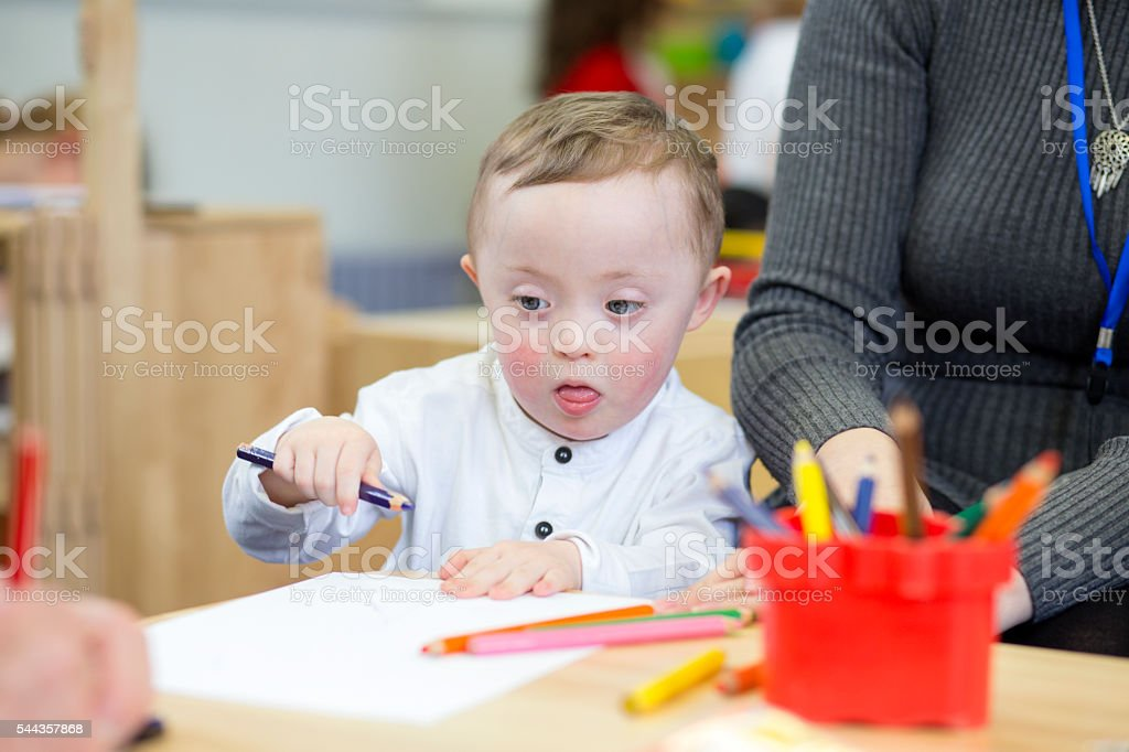Colouring in at nursery stock photo