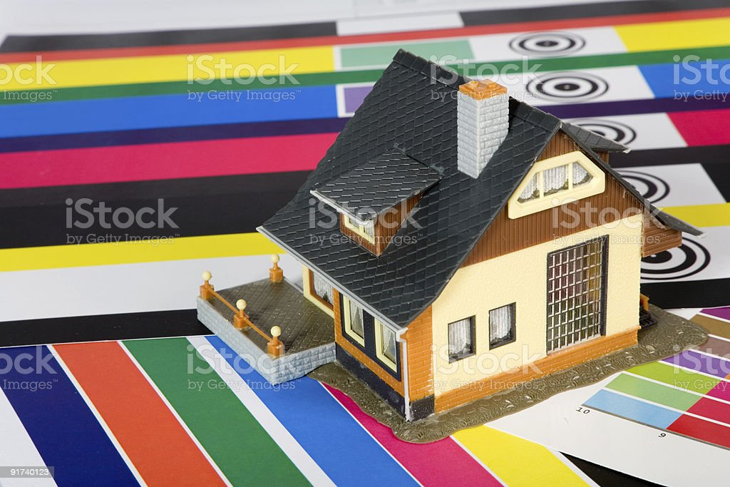 Colouring of the  house by a paint. royalty-free stock photo