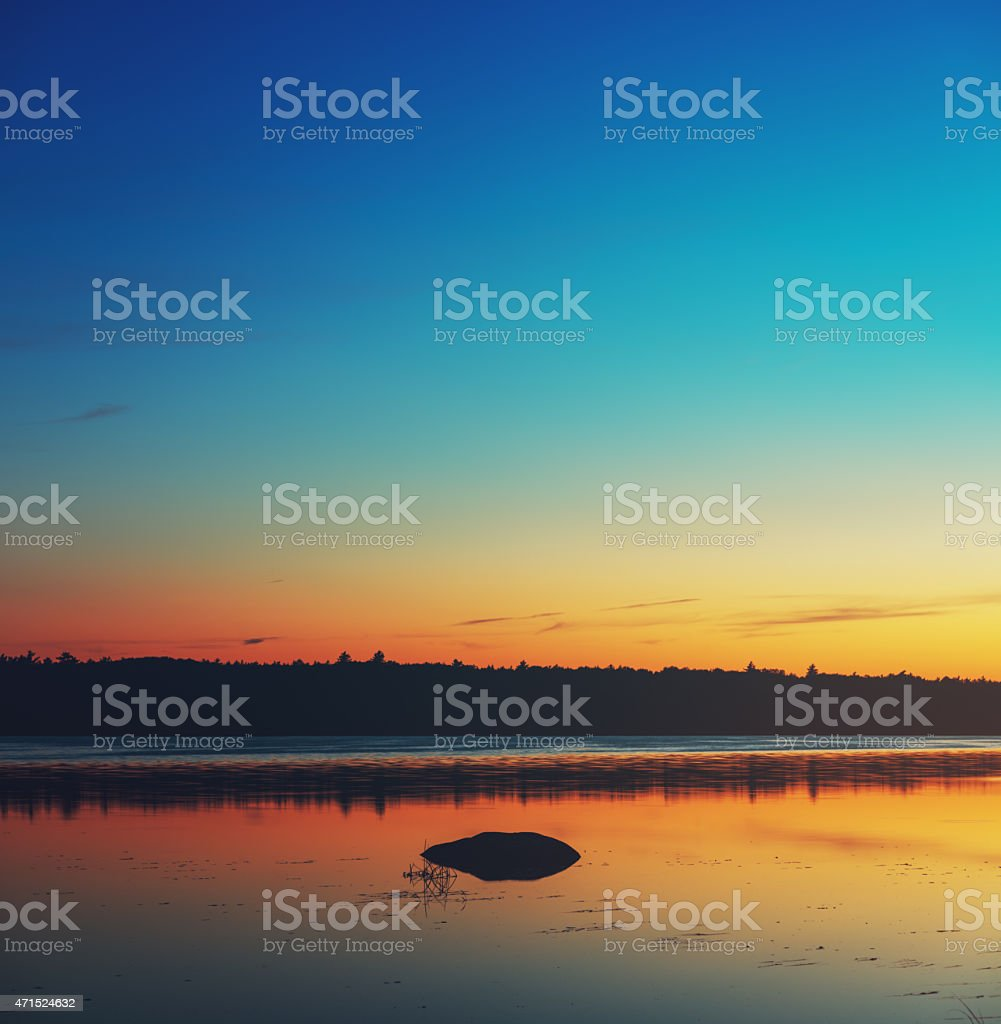 Colours of Twilight on Still Lake stock photo