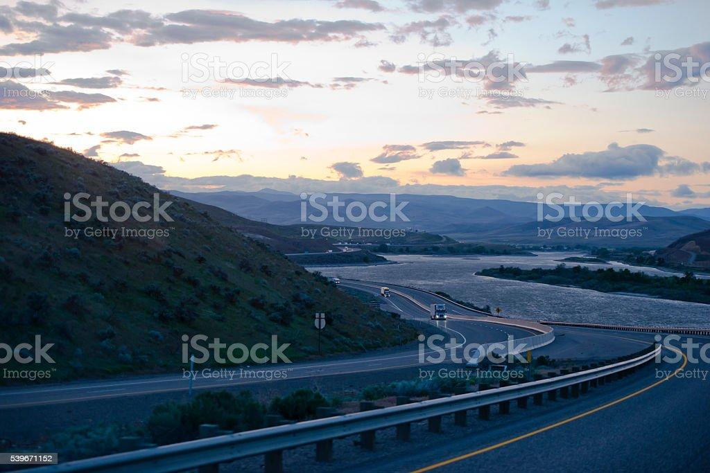 Columbia Gorge winding highway with semi trucks evening traffic stock photo
