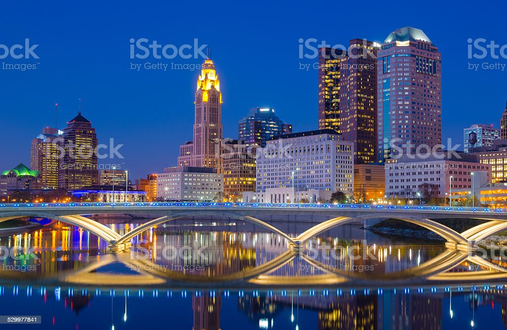 Columbus skyline at dusk / evening with river reflection stock photo