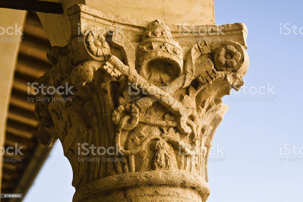 Column capital with Papal coat of arms royalty-free stock photo