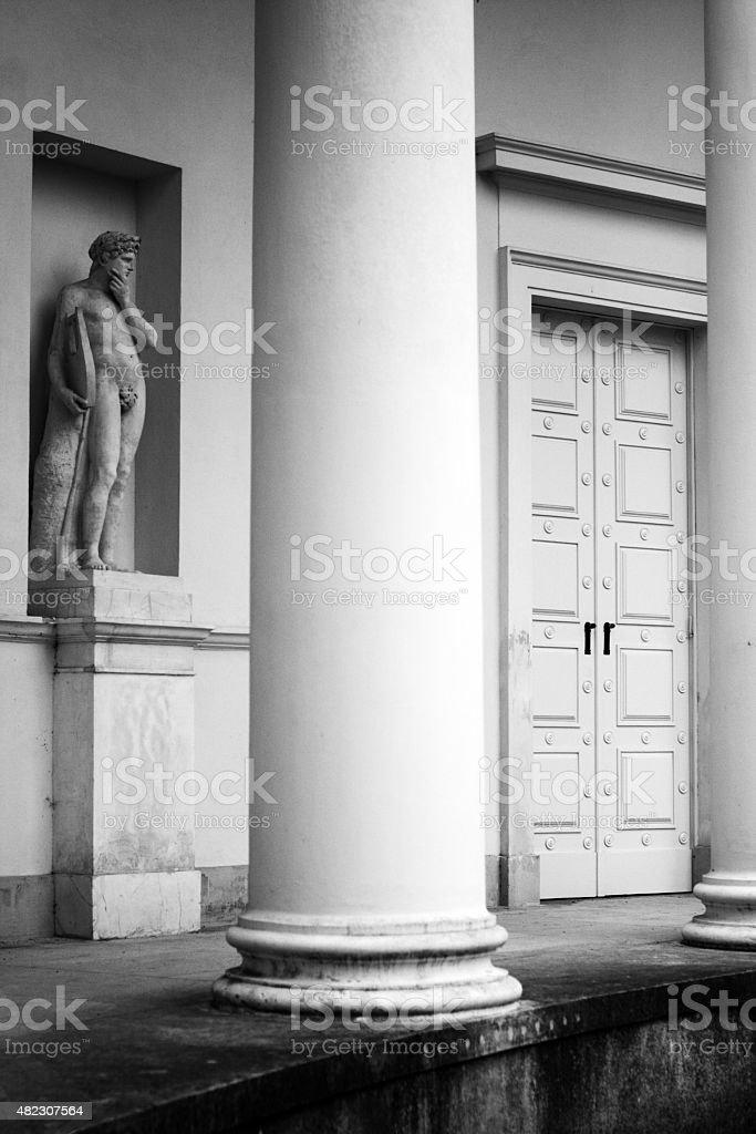 column, door and statue stock photo