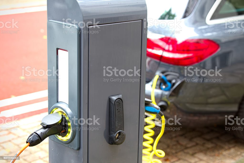 Column for recharging electric cars stock photo