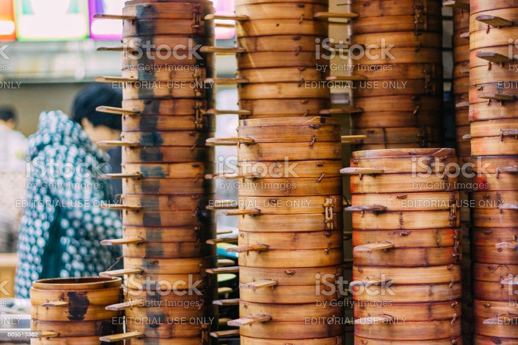 column of  steamer baskets of Dim Sum stock photo