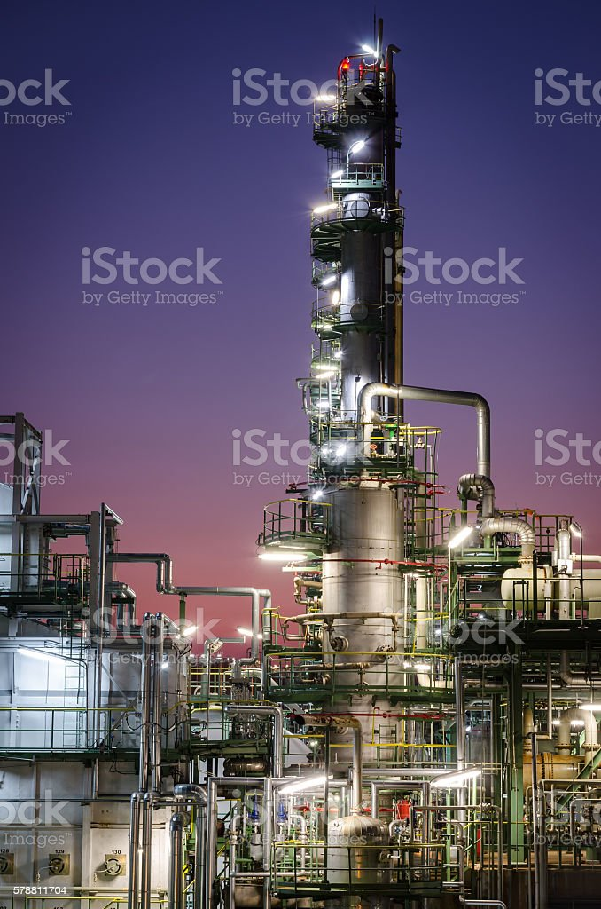 Column tower in petrochemical plant at twilight time stock photo