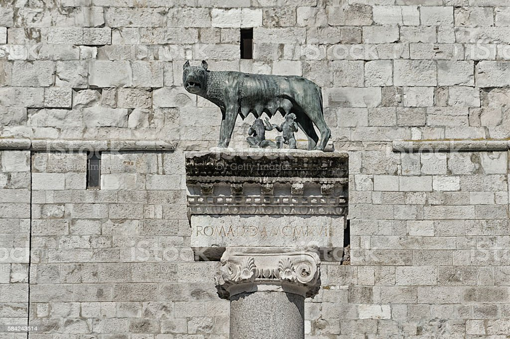 Column with capitoline Wolf statue, legend of Rome stock photo
