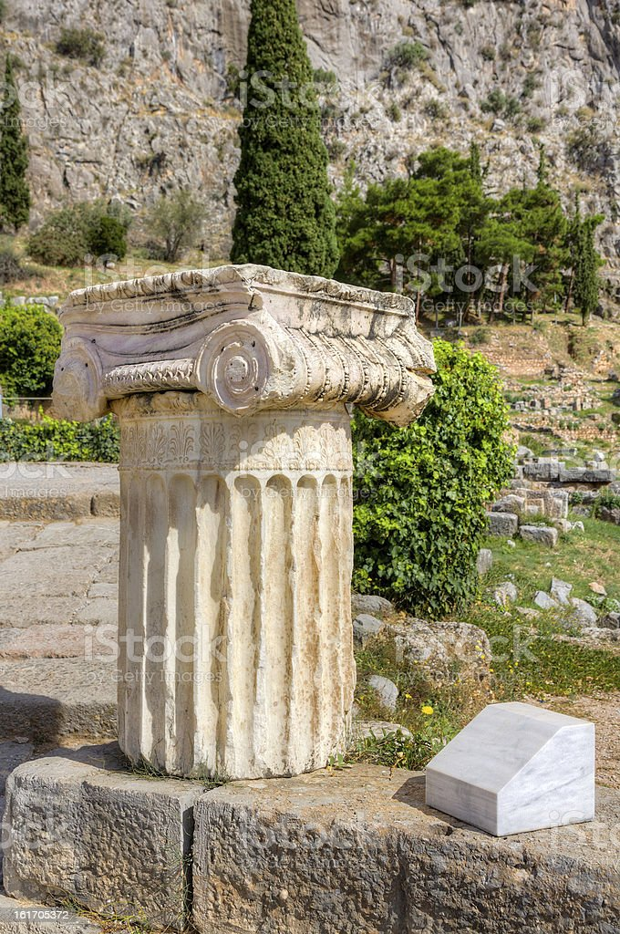 Column with Ionic capital in Delphi archaeological site, Greece royalty-free stock photo