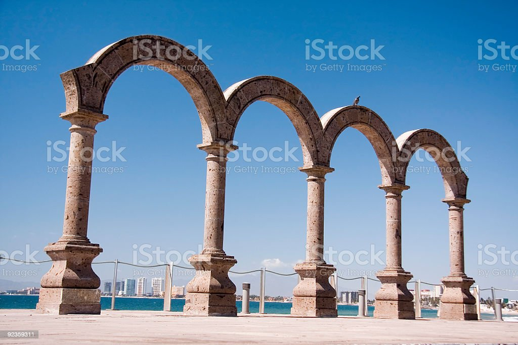 Columns and arches at Puerto Vallarta under a blue sky stock photo