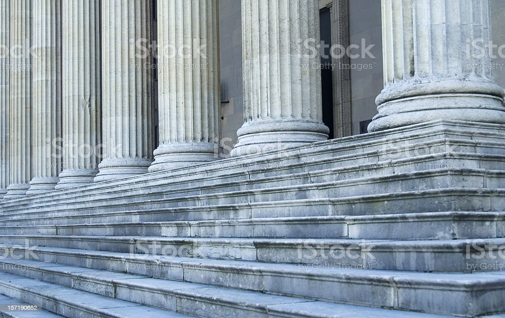 Columns and steps of a building's exterior stock photo