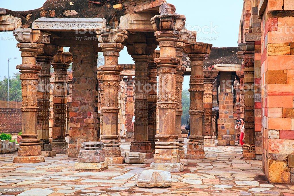 Columns at Quwwat ul-Islam Mosque in Qutab Complex, India stock photo