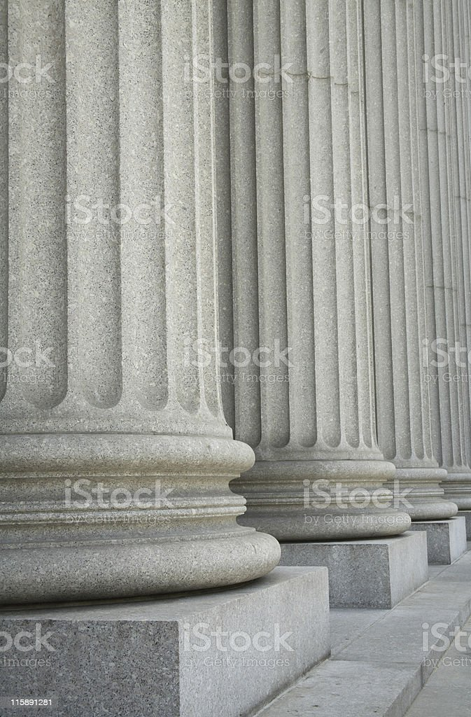 Columns forming a portico outside the Supreme Court, vertical stock photo