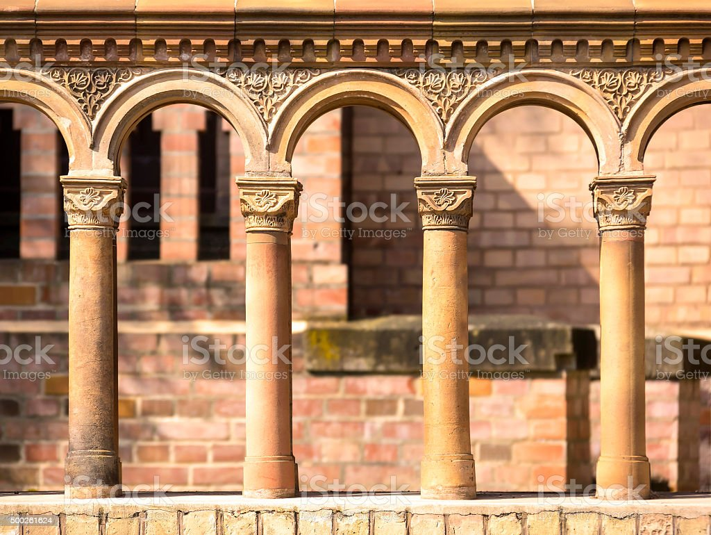 Columns in a row with terra cotta ornates stock photo
