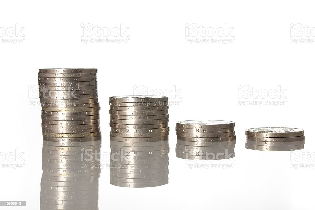 Columns of coins isolated on white color stock photo
