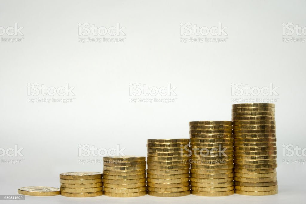 Columns of coins showing steady revenue growth stock photo