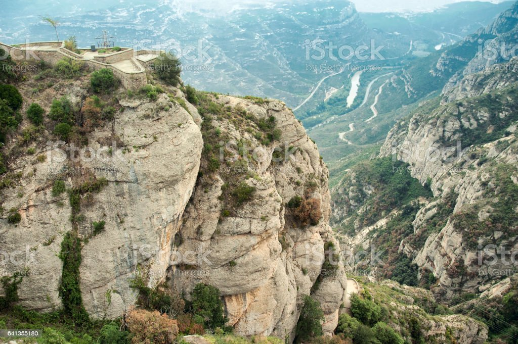 Columns of conglomerate rock stand out against the landscape at Montserrat, Spain stock photo