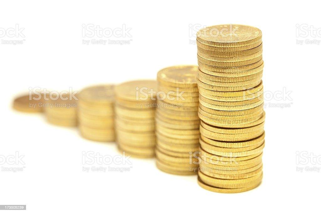 Columns of golden coins stock photo