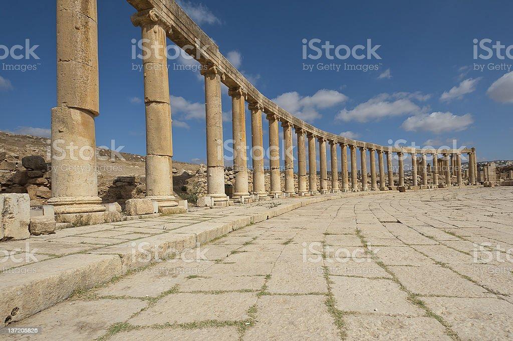 Columns of the Oval Plaza in Jerash, Jordan royalty-free stock photo