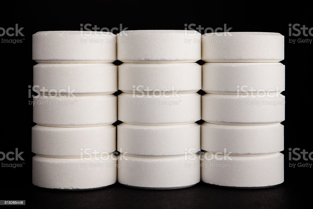 Columns of white tablets stock photo
