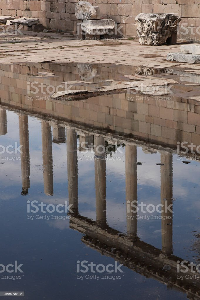 Colums reflected in water stock photo