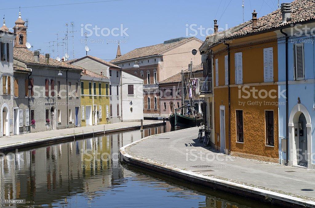Comacchio (Ferrara) - Canal and colorful houses stock photo
