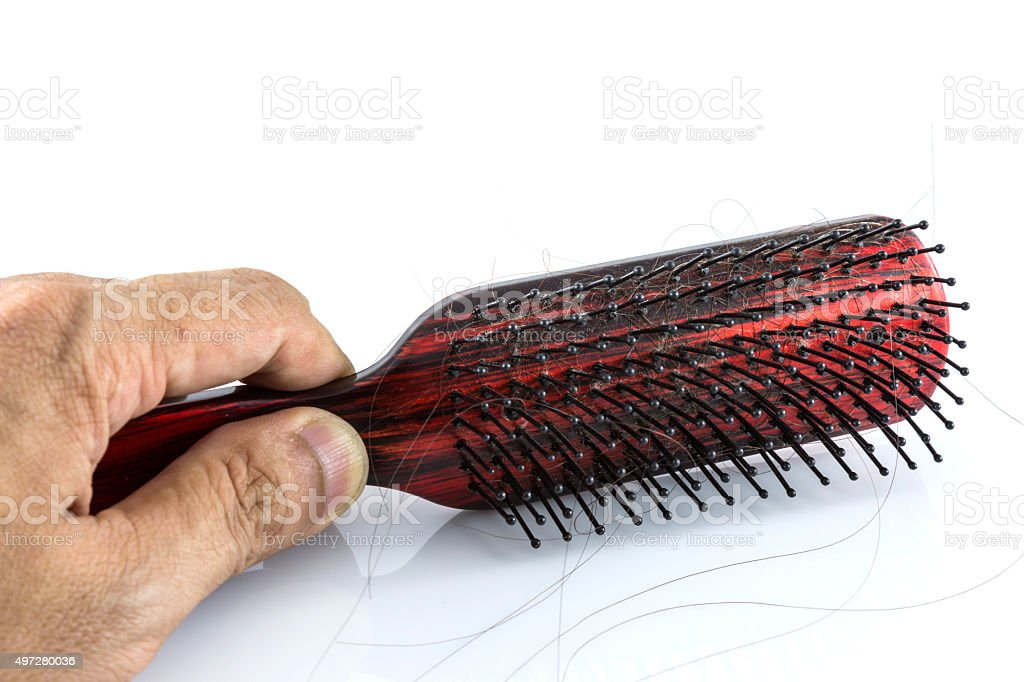 Comb and hair stock photo