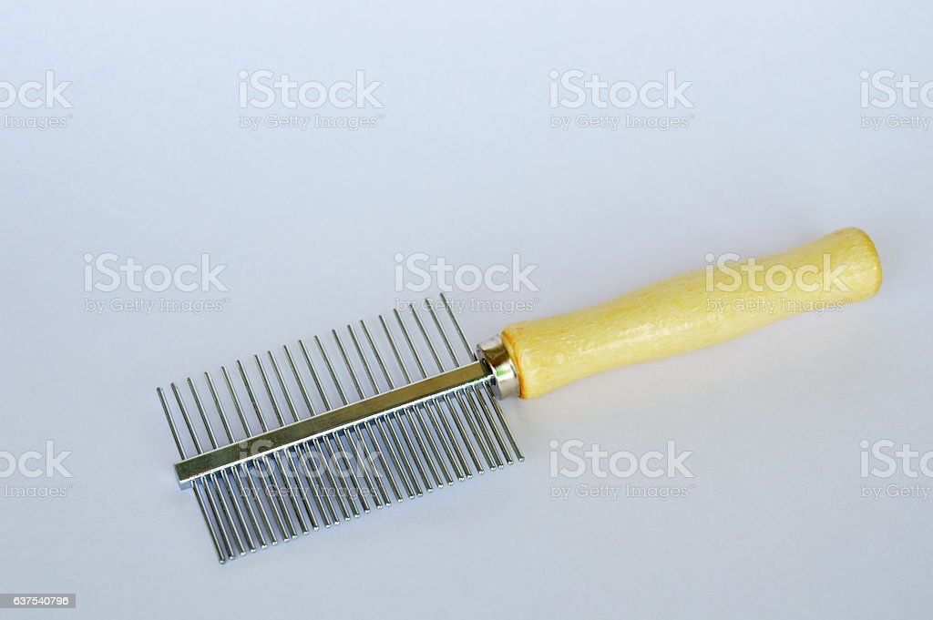 comb teeth away and fine side for dog or cat stock photo