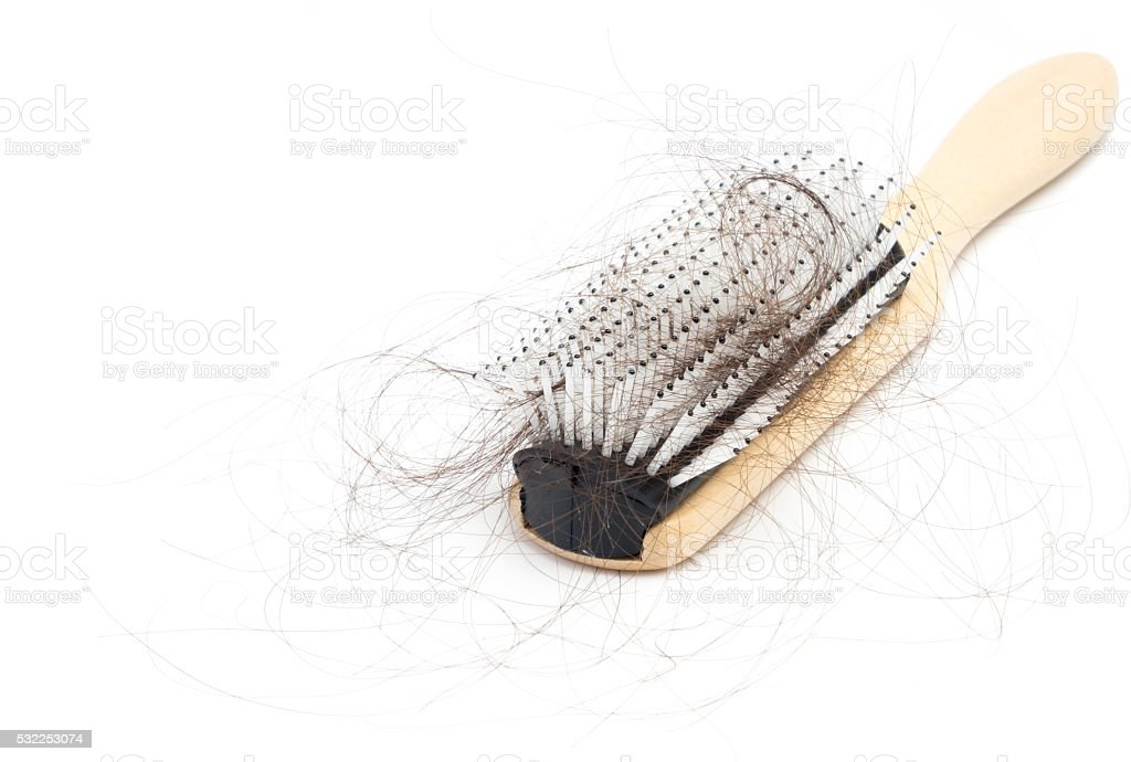 Comb with hair loss problem on white background stock photo