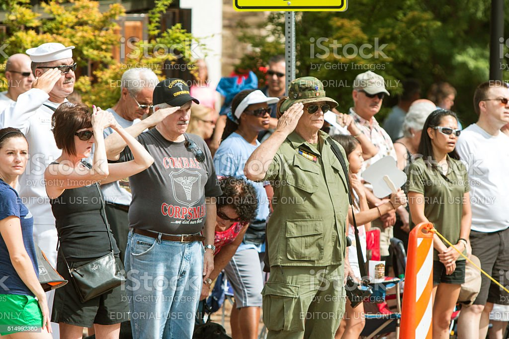 Combat Veterans Salute American Flag At Old Soldiers Day Parade stock photo