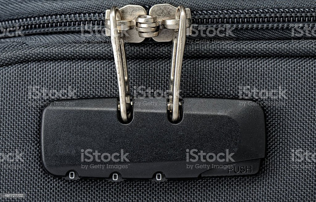 Combination lock for zipper on a suitcase stock photo