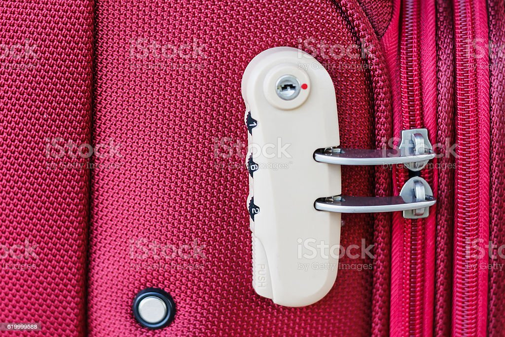 combination lock on red suitcase travel bag stock photo